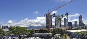 Halekauwila Place, whose crane is shown in the foreground, is one of 15 condominium projects known to be in the works in Kakaako. If all of the projects go forward, more than 4,000 units will be added to the market in the next five years.