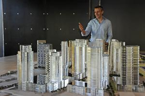 Nick Vanderboom, senior vice president of development for the Howard Hughes Corp, show a model of the company's plans to redevelop the 60 acres that is Ward Centers into a largely residential highrise community mixed with retail called Ward Village.