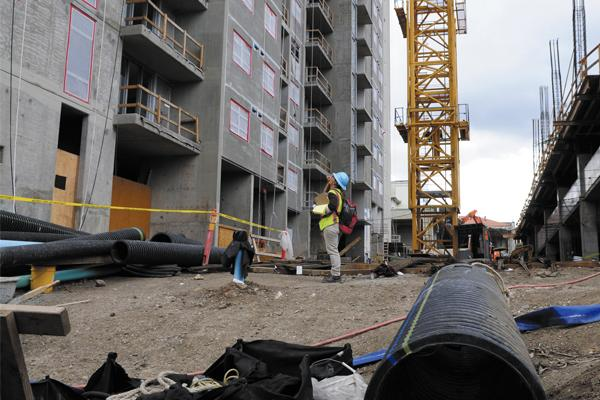 Workers are seen at the site of the first condominium tower at 801 South St., which is being built next to the former Honolulu Advertiser building. Developer Downtown Capital says all 410 units in the project's second tower have been sold to Hawaii residents.