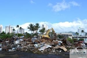 The Fisherman's Wharf building in Honolulu, which stood for nearly seven decades, was torn down Thursday.