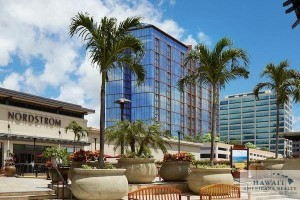 The Nordstrom department store at Ala Moana Center is seen in this photo depicting a rendering of the ONE Ala Moana luxury condominium project, recently completed construction atop the parking garage next to Nordstrom. Two penthouse units are on the market for a combined $22.3 million.
